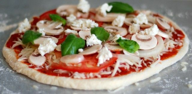 pizza-ingredients-on-pizza-dough